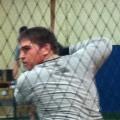 Junior Tom Nieman does pre-season batting practice in the multi-purpose room Feb. 15 (Jimmy Rizzo