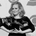 Adele holds her five Grammy Awards (photo from www.grammy.com)