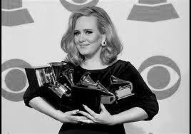 Adele holds her five Grammy Awards (photo from www.grammy.com)