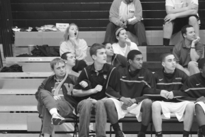 Alumnus Gus Mclean, senior Nathan Grobe and sophomores Stuart Hollandsworth and Rob Thompson anxiously watch the last few seconds of the Webster vs. Eureka game on Jan. 28. Photo by Kevin Killeen.