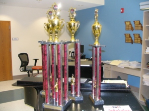 Choir students brought home these trophies from the Dallas Festival. Webster Groves won the Sweepstakes Award.  The Chamber and Concert Choirs won the Adjudicator's award, and Chamber Choir won the Outstanding Choral Award.  All three choirs won first place in their divisions. (Photo by John Binder)