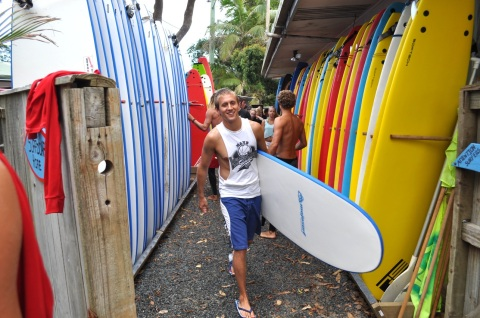 Justin Mathes prepares to catch some waves in Australia while studying abroad as a college student. Mathes now is in his first year of teaching math at Webster Groves High School. (Photo provided by Justin Mathes)