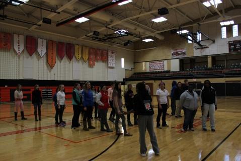 Senior Symone Palmer talks seniors through the Senior Line Dance choreography during a practice Nov. 13. (Photo by Aerin Johnson)