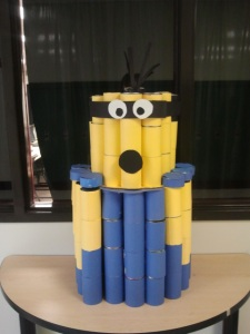"A canned ""minion"" is one of  DECA's ""canstructions."" The cans will eventually be given to Interact Club's food rive. (Photo by Jack Killeen)"