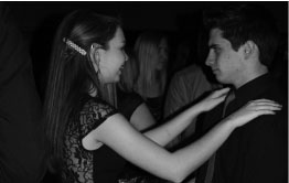 Photo by Bret Waelterman Freshmen Elizabeth Gilstrap dances with Rick Smith at the Winter Homecoming on Jan. 25.