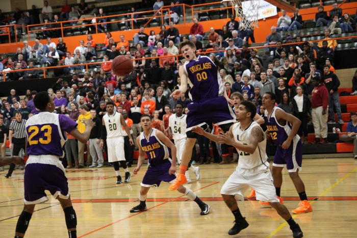 Junior Stephen Harris rebounds the ball as juniors Cameron Hilton, Alex Floresca and Sam Craig watch during last year's Douglass Night. (Photo from Lee Drake)