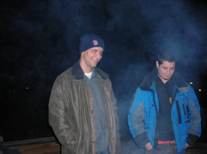 Counselor Ken Winingham and alumni Jack Carroll enjoy the campfire at the astronomy campout in March 2008. (Photo from CiCi Faucher)