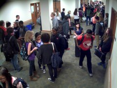 Socializing students contribute to hallway congestion. (Photo by hallway security camera)