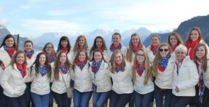 The St. Louis Synergy team poses for a picture outside the town of Salzburg, Austria, that offers a mountainous landscape. (By Karen Rosemann)