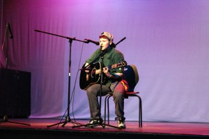 Alumnus Alex Otto performs in the 2014 SAA Talent show in the auditorium.  Photo by Donald Johnson