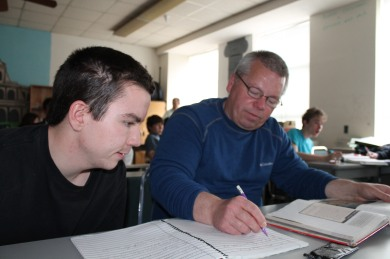 Senior Casey Scott works on Latin with the help of Roy Stevens. Latin II is one of three classes Stevens helps Scott in during the day. (photo by Jack Killeen)