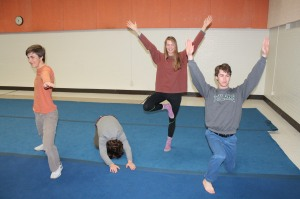 Juniors Charlie DeYoung, Wes Wride and Sydney Garland and senior Sam Short exhibit different yoga poses after a club meeting in the old band room on March 24.