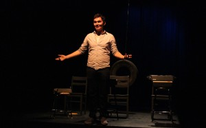 Senior Duncan Kinzie introduces the directors of three one acts by David Ives. Kinzie has been involved in theater and was a officer of Thespian Troupe 191.  (Photo by Donald Johnson)