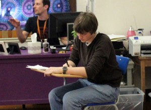 Senior Ryan Tumminello works on schoolwork in the drama room during one act auditions. (Photo by Aerin Johnson)