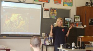 Career photojournalist Krista Kennell shows some of her equipment to journalism students on Aug. 12. (Photo by Abby Botan)
