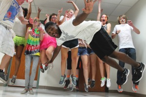 Senior De'Andre Scott jumps and dances with other students at the Back in Black Dance on Aug. 22.