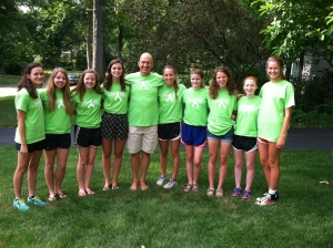 Coach Ken Manwarring and several of his cross country athletes from last year wear Team Ken T-shirts to help raise money and support Manwarring, who is dealing with multiple myeloma and amyloidosis. (Photo by Jane Manwarring)