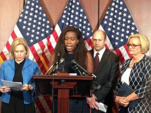 Sen. Kirsten Gillibrand, D-NY, from left, Wagatwe Wanjuki of Know Your IX, Scott Berkowitz of RAINN, and Sen. Claire McCaskill, D-MO, speak at the Campus Accountability and Safety Act press conference, Wednesday, July 30, 2014, in Washington.  (Stephanie Haven/MCT)