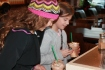 Lulu and Sylvia add sugar to their cups at Starbucks after buying matching Frappuccinos. (Photo by Caroline Fellows)