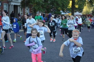 Runners start the 5k and One-Mile Fun Run on Selma ave. for the 2014 Ivory  Crockett Run4Webster on Oct. 18.