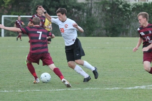 Junior Sheriden Smith battles for the ball against Summit on Sept. 2.  (Photo by Bret Waelterman)