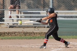 Freshman Karlee Sholtes hits the ball during a Freshman softball game at Plymouth Field. (Photo by Bret Waelterman)