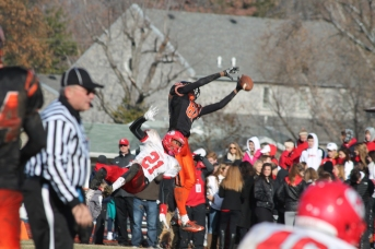 Antonio Phillips (21), sophomore,  attempts to block John Thomas (87), sophomore, as catches the pass at the Turkey Day game. (Photo by Bret Waelterman)