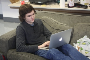 Senior Harry Gallagher codes on his laptop during lunch in math teacher Eric  Dunn's room. (Photo by Alex Ring)