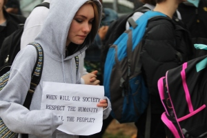 Junior Eartha Swartz sports a sign outside WGHS during the walkout protest on Dec. 4. (Photo by Aerin Johnson)