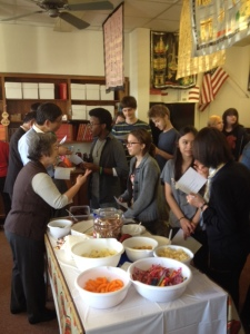 Students converse with the Japanese visitors and snack from a table of food during the festivities on Oct. 28, celebrating the 40-year anniversary of the St. Louis-Suwa Sister City Program. Photo by Stephen Knapp.