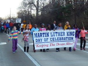 Members of the Webster Groves community marched through the streets preceding the event at Steger in January 2015. Photo by Caroline Fellows.