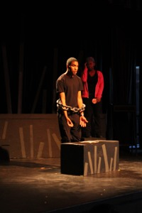 Dorian Palmer, junior, performs a spoken word poem during the Black History Month Showcase in the All Write Festival in the Little Theater on Feb. 24. (Photo by Bret Waelterman)