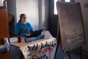 English teacher Amie Keane sells All Write Week T-shirts outside the Little Theater between presentations. All Write Week was Feb. 24-27. Photo by Aerin Johnson