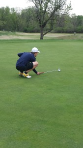 Junior Jameson Howard on the green attempts to line up his putt during a practice at Tower Tee. (Photo by Cary Morrison)