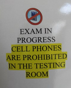Signs outside of classrooms such as this one indicate when EOC testing is taking place.