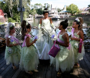 Princess Tiana, center, greets local girls dressed as little Princess Tianas during her debut day in the Magic Kingdom, at Walt Disney World, Monday, Oct. 26, 2009, at Lake Buena Vista, Florida. (c) 2009, Orlando Sentinel. Distributed by McClatchy/Tribune Information Services. Photo Credit: Joe Burbank/Orlando Sentinel/MCT)