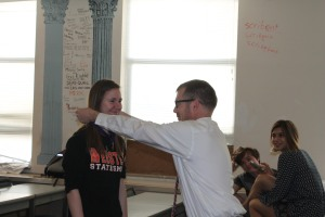 Sophomore  receives a medal from Latin teacher Jeff Smith during first hour