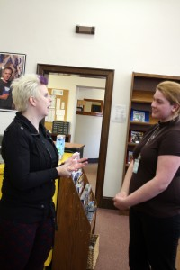 Author Heather Brewer talks to senior Aerin Johnson after speaking at the All Write Festival Feb. 24.  Photo by SeVana Bierman