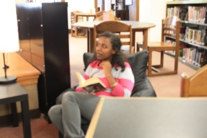 Senior Muna Abdella-Hazak studies in the library which helps contribute to her high grades and awards.  Photo by Brittany Patton
