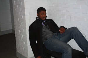 Senior De'Andre Scott relaxes in drama hall during his free period. Photo by Brittany Patton