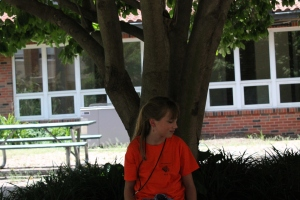 Junior journalist Hadley Hoskins enjoys the shade at the ECHO journalism camp, July 14.
