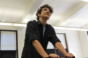 "Junior Rowan Van Horn rehearses his role as Claudius for the upcoming performance of ""Hamlet."" The play will be Oct. 22-24, in the auditorium."