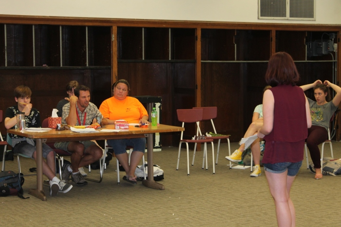 """Hamlet"" director Todd Schaefer coaches sophomore Sydney Ciamarolli at Hamlet auditions on Friday, Aug. 28. Around 40 students auditioned and 19 were cast. Photo by Caroline Fellows"