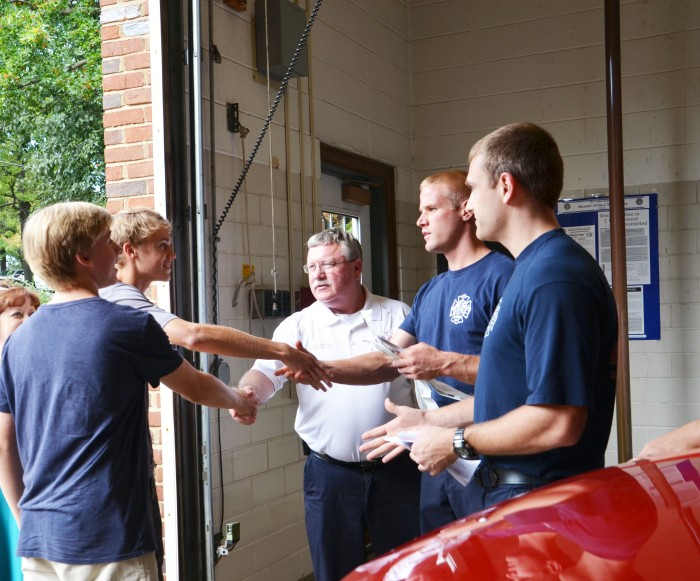 History Club members junior Thomas Hotaling and sophomore Matt Lehmann delivered notes of thanks to the first responders at WG police and fire depts. on Sept. 11 along with sponsor Julie Burchett.