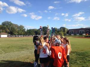 Varsity field hockey team holds a team meeting during its game on Oct. 2 against Edwardsville. Webster lost 3-0. Photo by Jason VanBlarcum