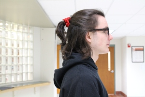 Junior Jack Austin puts his hair in a version of his bun. Photo by Abby Botan