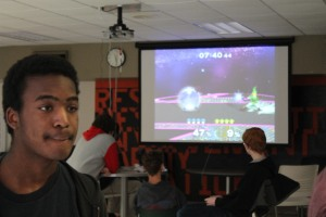 Eighth grader Evan Palmer looks on as students compete in the Super Smash Bros. Melee tournament. The tournament was sponsered by DECA to support its annual trip to New York. Photo by Jack Killeen