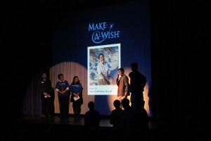 John Binder talks to the audience about Make A Wish fundraiser during Mr. Webster  with some of the volunteers who know and work with Carter Dec. 3.Photo by Ashli Wagner.