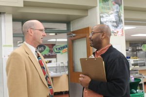 Dr. Clark talks with vice principal John Thomas in between lunches. Photo by Ashli Wagner.