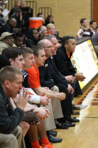 On Feb. 11, Principal Jon Clark became part of the line of Webster coaches dominates the Statesmen bench. On the far left, usual head coach Jay Blossom tries to refrain from yelling. Photo by Jack Killeen